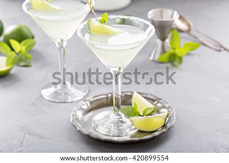 Lemonade martini cocktail garnished with lime and mint - stock photo