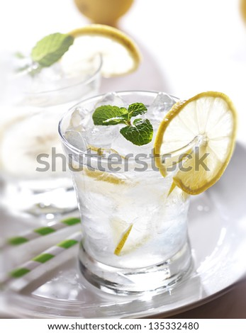 lemonade with ice and mint - stock photo