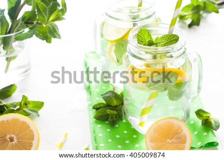 Lemonade with mint in a mason jar on a white background. Summer drink. - stock photo
