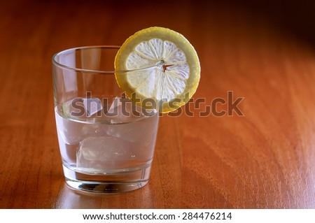lemonade with piece of lemon closeup - stock photo
