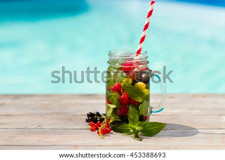 Lemonade with raspberries, currant and gooseberry