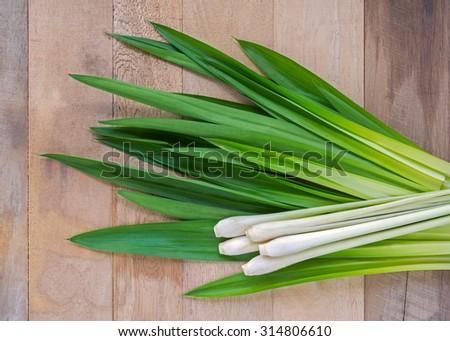 Lemongrass leaf and fresh pandan leaves on wooden tabel - stock photo