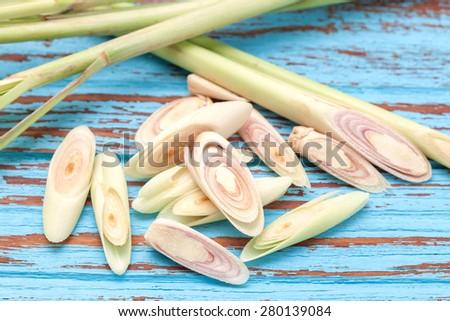 lemongrass slice aromatic  fresh fragrant  tom yam ingredient  background  blue wood  teak still life - stock photo