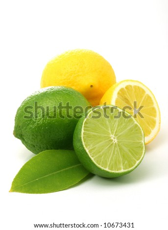 Lemons and green limes over white - stock photo
