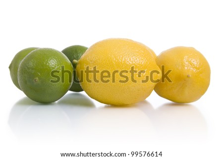 Lemons and limes, isolated on white.