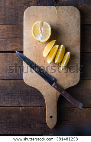 lemons cut open on a cutting board - stock photo