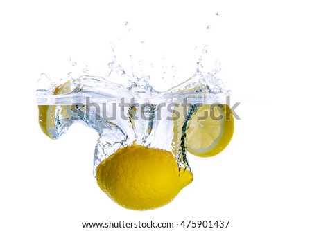 lemons falling in to water with splash