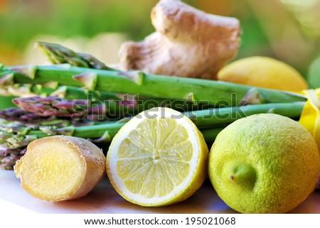 Lemons, ginger and vegetables - stock photo