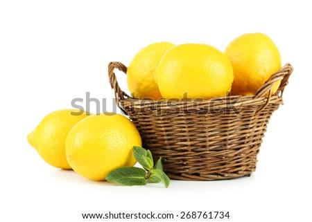 Lemons in basket isolated on white - stock photo