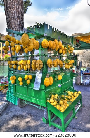 Lemons on a shop at a promenade by the Lago di Garda - stock photo