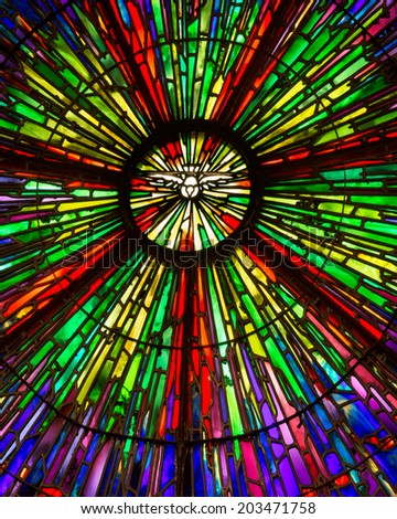 LEMONT, ILLINOIS - JULY 7: Stained glass window inside the St. Patrick Catholic Church on July 7, 2014 in Lemont, Illinois - stock photo