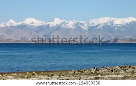 Lenin Peak Pik Lenin behind Karakul Lake, Pamirs, Tajikistan - stock photo
