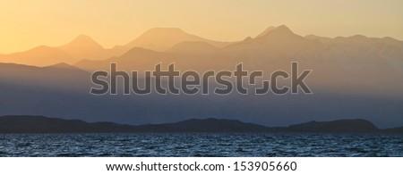 Lenin Peak Pik Lenin behind Karakul Lake, Pamirs, Tajikistan, at sunset - stock photo