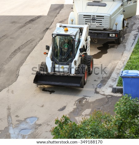 Leningrad region, Russia - 15 June, 2015. Landscaping and asphalting of yards. Mini Loader for small works.
