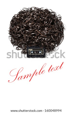 Lenny Kravitz - A head with afro hairdress made of audio tape. - stock photo