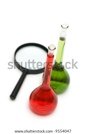 Lens and coloured tubes isolated on the white - shallow DOF - stock photo