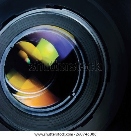 Lens and hood large detailed macro zoom closeup, colorful glass reflections - stock photo