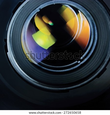 Lens and hood, large detailed macro zoom closeup, glass reflections - stock photo