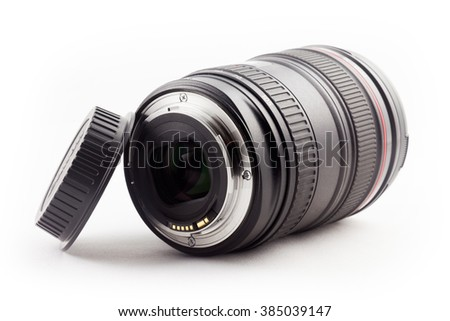 Lens and lens cap - studio recording in front of white background