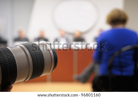 Lens at press conference. - stock photo