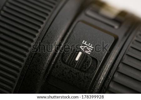 Lens autofocus button close-up. - stock photo