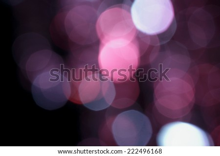 lens flare blurry effect  sparkling coloful lights on black - stock photo