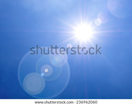 lens flare in the afternoon on blue sky background - stock photo