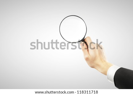 lens in hand  on a white background - stock photo