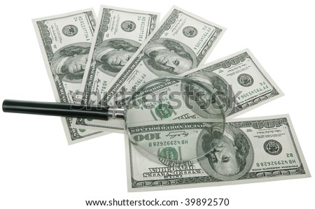 lens (magnifying glass) lying on top of Dollars