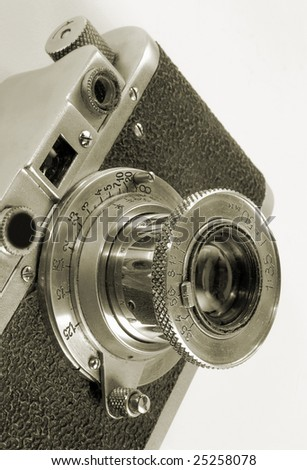Lens of antiquarian photo camera. - stock photo