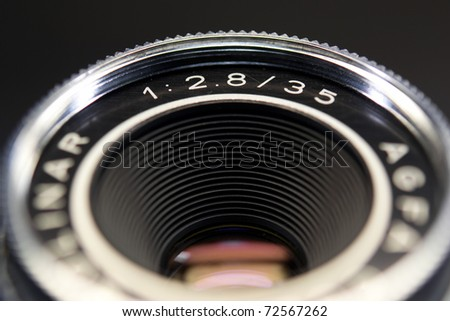 lens of old 35mm camera - stock photo