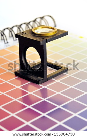 lens on color book - stock photo