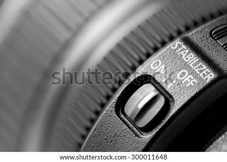 Lens stabilizer on off switch or slider button closeup