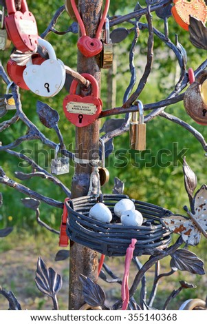 Lensk, Yakutia-June 20, 2014: Street art object tree with a metal basket with eggs and castles