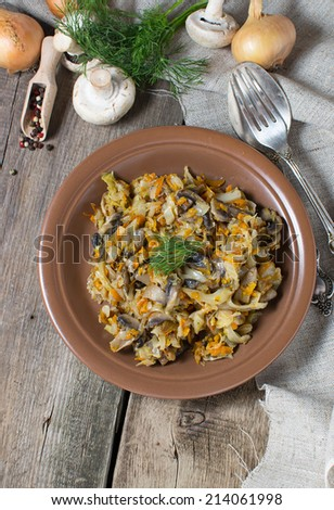Lenten stewed cabbage with mushrooms and carrot - stock photo