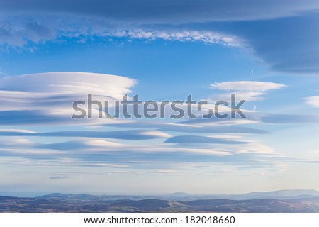 Lenticular clouds forming in the troposphere - stock photo