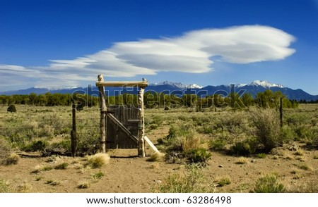 Lenticular clouds over the mountains and desert near Great Sand Dunes in Eastern Colorado. - stock photo