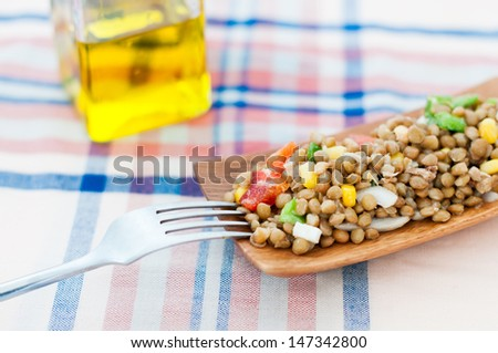 Lentil salad with boiled egg and pepper - stock photo