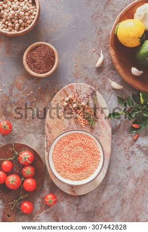 Lentil soup ingredients.  Red lentil soup with chickpeas, zucchini and spices  being prepared, top view - stock photo