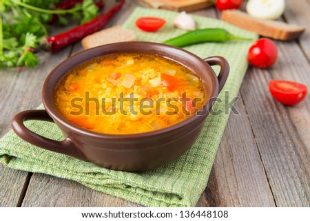 Lentil soup with tomatoes - stock photo