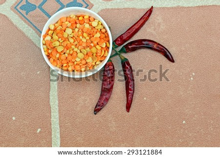 Lentils and red chili pepper. - stock photo