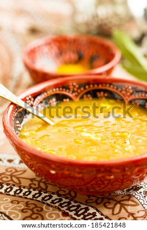 Lentils and tamarind soup - stock photo
