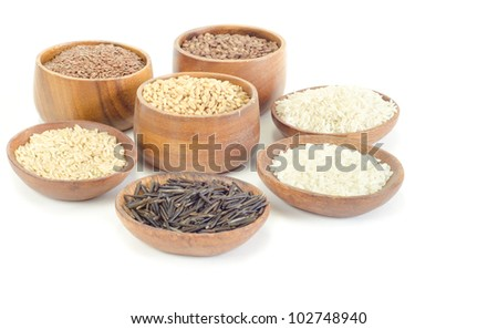 Lentils, flax, wheat, wild, brown and white rices on white - stock photo