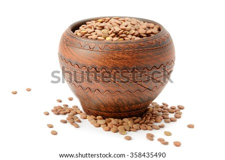 lentils in a clay pot isolated on white background - stock photo