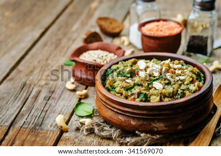 lentils mushroom spinach quinoa on a dark wood background. toning. selective Focus - stock photo