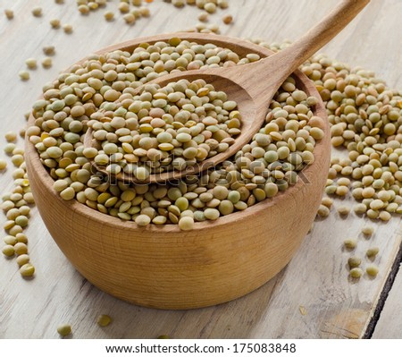 lentils on a wooden table . selective focus