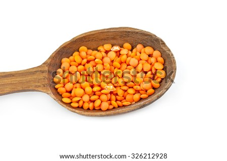 lentils wooden spoons isolated on a white - stock photo
