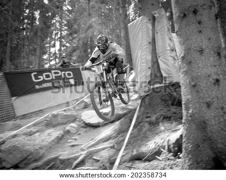 LEOGANG, AUSTRIA - JUNE 15, 2014: Sam Dale of Madison Saracen Factory Team is seen during pre-final training at the UCI Downhill Mountain Bike World Cup in Leogang, Austria.