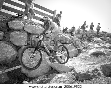 LEOGANG, AUSTRIA - JUNE 13, 2014: Troy Brosnan of Specialized Racing DH is seen during training of the UCI Downhill Mountain Bike World Cup in Leogang, Austria.