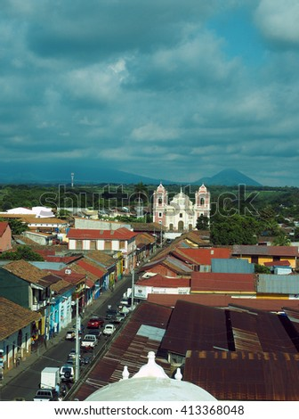 LEON, NICARAGUA-OCT. 24: Panoramic view of cathedral in historic Leon, Nicaragua is seen with mountain in background on October 24, 2014.
